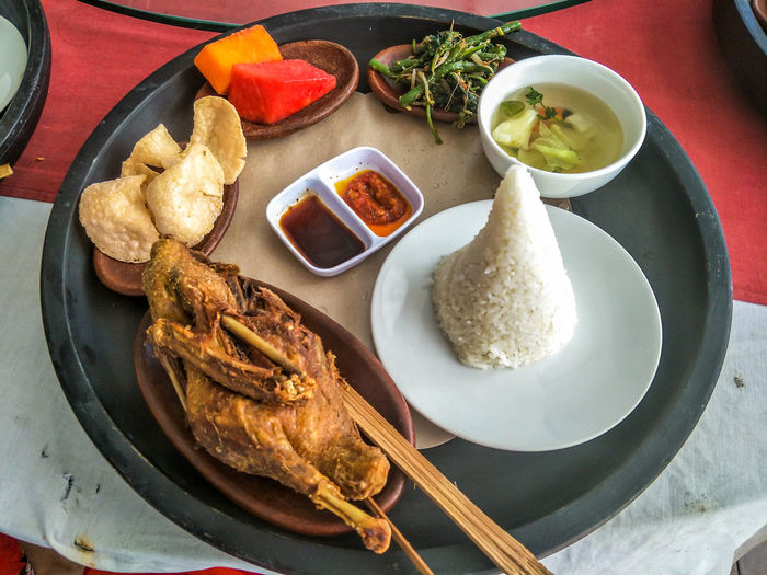 A delicious and dirty duck meal on Bali Bali Banquet Cake Catering Characteristic Cooking Cuisine Delicious Dirty Duck Meal Duck Eat And Drink Food Fried Healthy Eating INDONESIA Lunch Party Relish Sightseeing The Traditional Cooking Tourism Travel Food And Drink Ready-to-eat Plate Freshness Bowl Table High Angle View Meat Serving Size Indoors  Still Life Asian Food Wellbeing No People Chopsticks Condiment Meal Seafood Savory Sauce Tray
