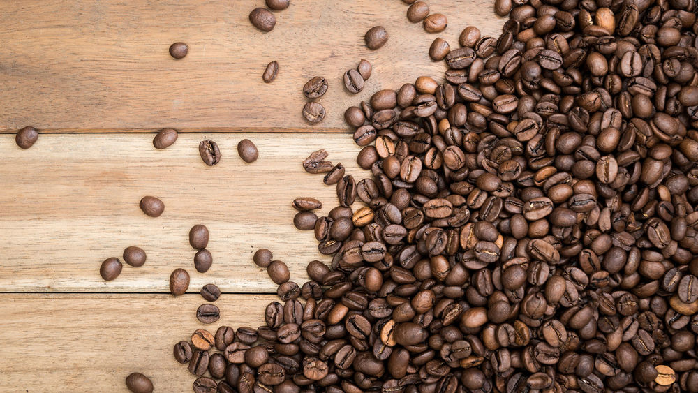 Coffee beans on wooden background Backgrounds Bean Brown Cafe Close-up Coffee Coffee Bean Coffee Cup Copy Space Cup Food And Drink Freshness Glass Indoor Indoors  Mug No People Seed Still Life Wood Wooden