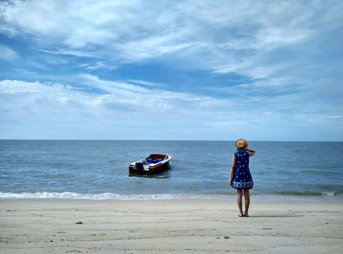 A blue-dressed girl under the deep blue sky...