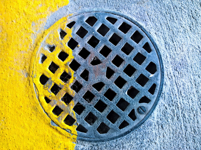 Background Cover Design Circle Drainage Urban Jungle Abstract Asphalt Jungle Backgrounds City View  Close-up Cover Day Detail Drain Cover Iron Isolated Lid Line Lines Manhole Metal Number Old Outdoor Parking Pattern Pavement Road Round Rusty Sewer Shape Sidewalk Space Steel Street Symbol Texture Urban Water Yellow No People Yellow