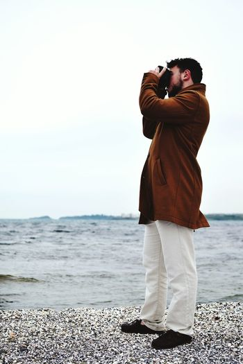 Man photographing on beach