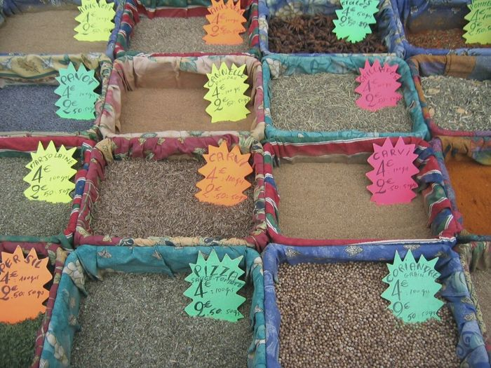 High Angle View Of Various Spice For Sale At Market Stall