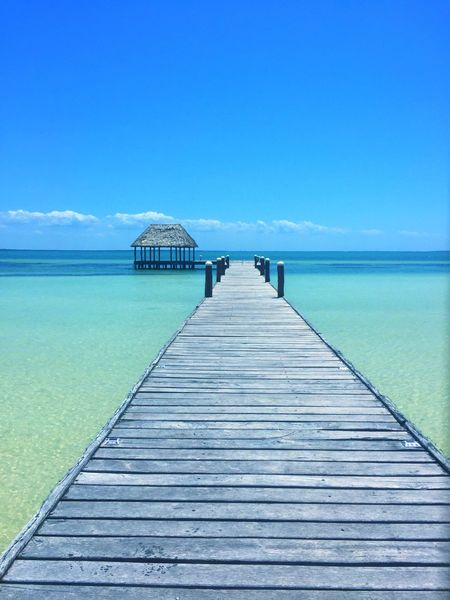 Pier Sea Tranquil Scene Horizon Over Water Clear Sky Scenics Idyllic Nature Beach Beauty In Nature Low Angle View Holbox Island No People Deck Blue Day Caribbean Sea