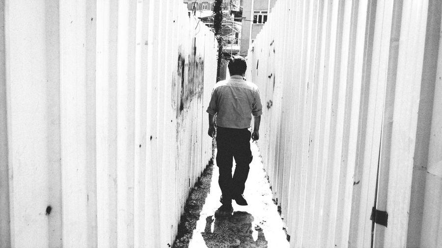 Full length of man walking away