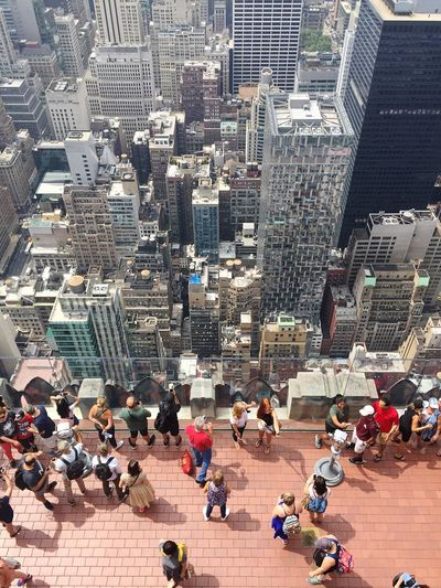 Skyscraper Building Exterior Architecture City Large Group Of People High Angle View Cityscape Built Structure Travel Destinations Crowded City Life Aerial View Day Urban Skyline Outdoors Real People Crowd People Adult