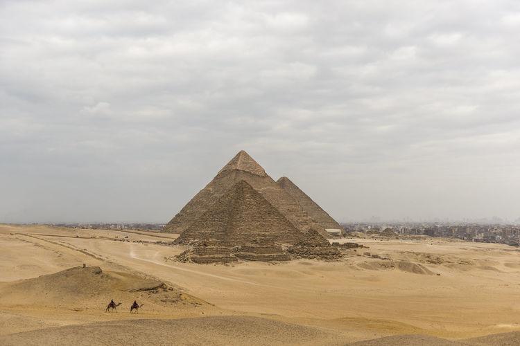 Pyramids against cloudy sky