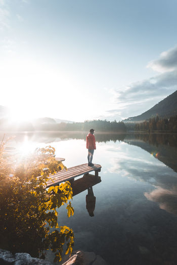 Water One Person Beauty In Nature Real People Full Length Tranquility Lake Scenics - Nature Nature Sky Reflection Lifestyles Tranquil Scene Sunlight Leisure Activity Non-urban Scene Day Vacations Outdoors Looking At View Sunrise Reflection Hintersee Hiking Adventure