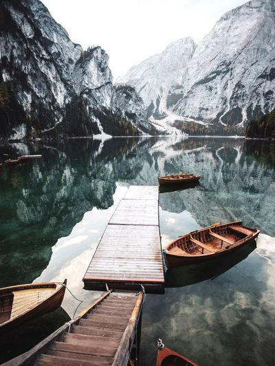 Mountain Wood - Material Scenics - Nature Lake Cold Temperature Beauty In Nature Water Winter Nature Tranquility Non-urban Scene Day Snow Tranquil Scene No People Mountain Range Sky Idyllic Outdoors Snowcapped Mountain Lago Di Braies Rowboat Scenics Nature Italy