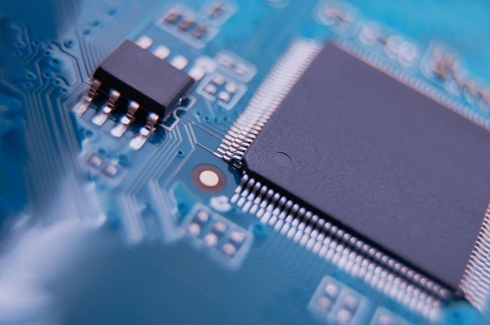 Technology Computer Chip Electronics Industry Circuit Board Computer Equipment Computer Equipment Close-up Connection Industry Mother Board Computer Part CPU Electrical Component Blue Electrical Equipment Global Communications Connection Block Motherboard Chipset Complexity Selective Focus