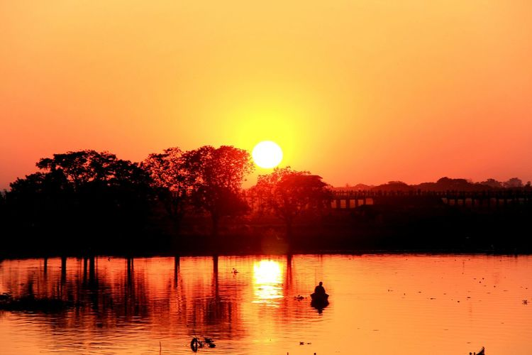Reflection Sunset Sky Water Orange Color Beauty In Nature Sun Lake Nature Tranquility Bird Silhouette Animal Themes Animal Scenics - Nature Tranquil Scene Animals In The Wild Sunlight Outdoors No People Mandalay, Myanmar