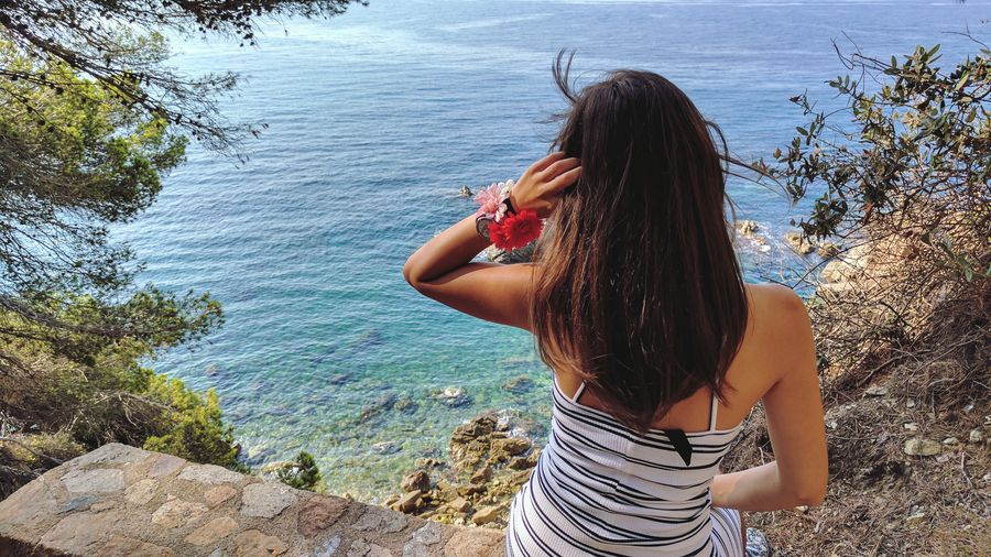 Water One Person Sea Long Hair Leisure Activity Day Only Women Adults Only Adult Summer Beach One Woman Only Women Nature Outdoors Lifestyles People Real People Young Women Young Adult Lloret De Mar Landscape Barcelona Spaın Horizon Over Water