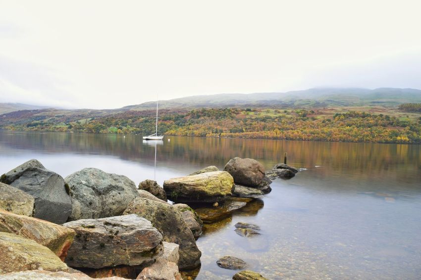 Boat on the Loch Reflection Lake Water Nature Tree Scenics No People Tranquility Sky Beauty In Nature Outdoors Landscape Day Mist Clouds Loch Tay Loch  Mountain Scotland Autumn🍁🍁🍁 Scotlandsbeauty