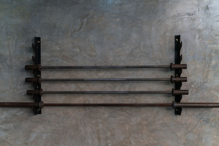 Rack With Barbells On Wall In Gym