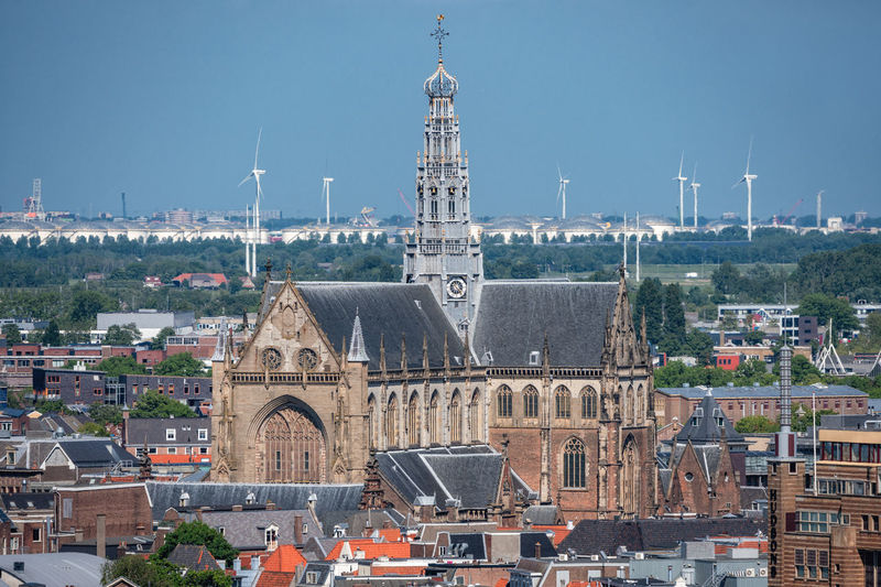 Architecture Built Structure Building Exterior City Building Travel Destinations Tower Place Of Worship Sky Religion History Travel Tourism Tall - High Cityscape No People Outdoors Haarlem Church Architecture Holland Aerial View High Angle View Closeup City Town Daytime Sunshine Windmills Roofs