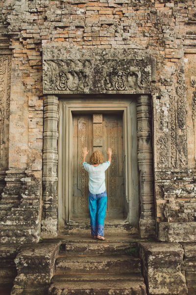 Siem Reap Cambodia Angkor Curly Hair Girl Architecture One Person Built Structure Full Length Building Exterior Rear View Standing Building History Casual Clothing The Past Day Real People Door Women Staircase Lifestyles Old Leisure Activity Outdoors Stone Wall