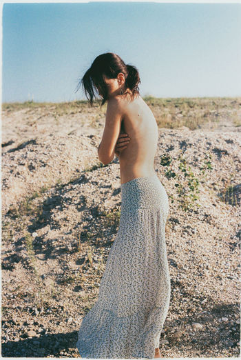 Analog Analogue Photography Beach Beuty Day Film Film Photography Fine Art Photography Lifestyles Mood Nature One Person Outdoors Sand Sand Dune Shirtless Shirtless Standing Summer Sunlight Toplesswoman Warm Colors