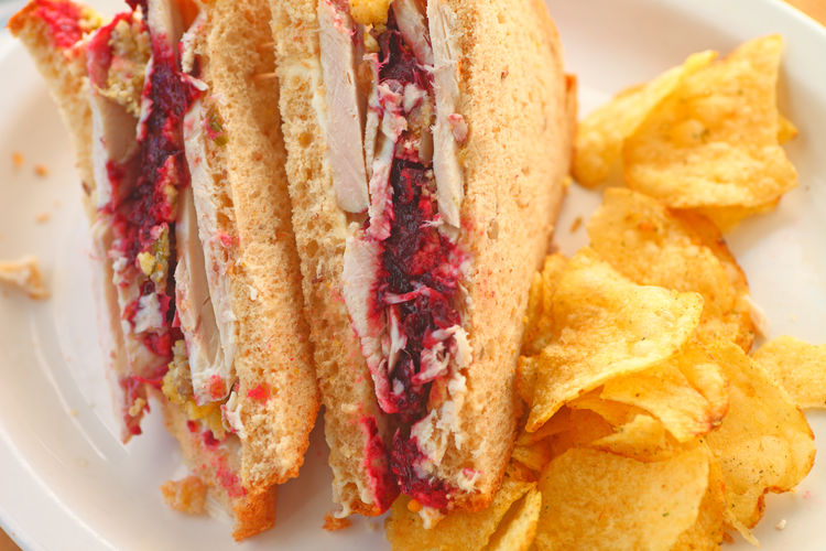 Turkey sandwich with potato chips Food Ready-to-eat Plate Close-up Indoors  Meal Snack Freshness No People Bread Lunch Thanksgiving Leftovers Sandwich Turkey Cranberry Sauce  Potato Chips Crisps Delicious Studio Shot Natural Light Textures Healthy Eating Poultry