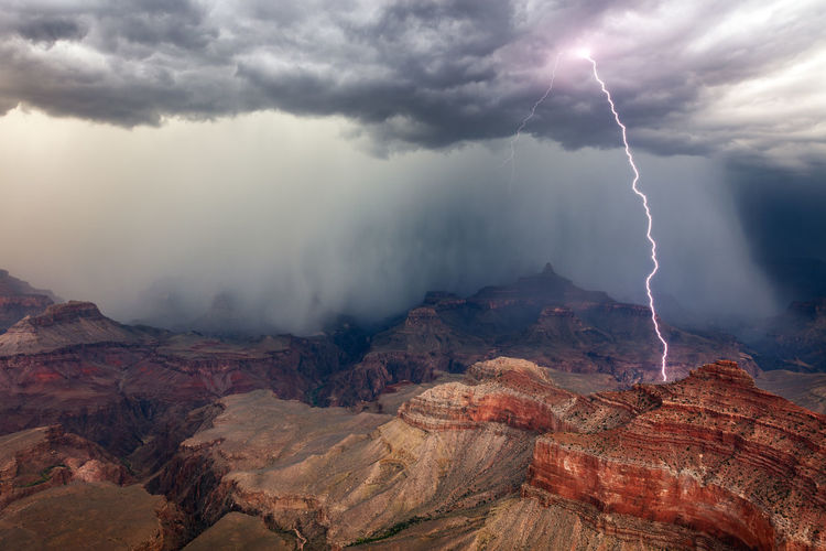 Lightning strikes from a thunderstorm over the grand canyon in grand canyon national park, arizona