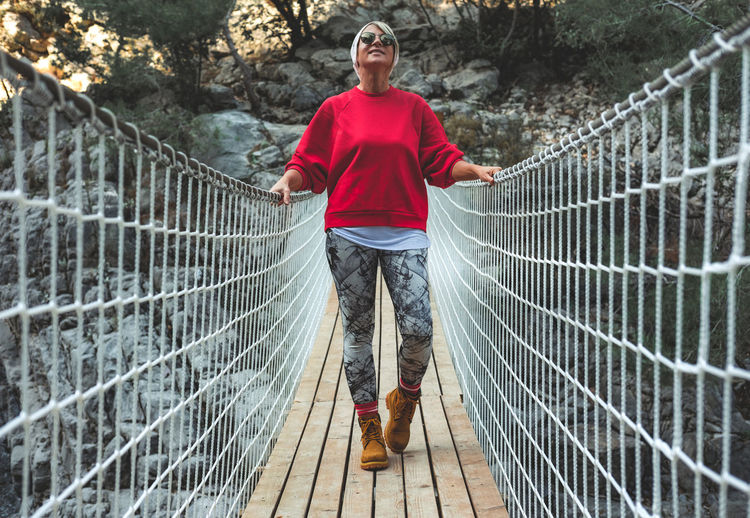 Full length of man standing on footbridge