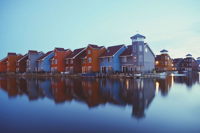Reflection Water Architecture Illuminated Sunset Built Structure Building Exterior Outdoors Sky Multi Colored No People City Modern Day Architecture Architecturelovers Architecturephotography Groningen Holland Reitdiephaven Harbour Harbourside Harbour View