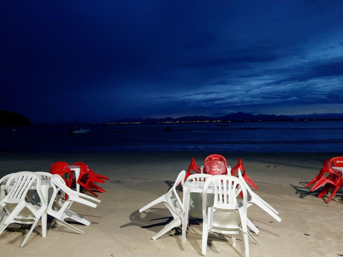 Chair Ocean Sea Night No People Red Chair Empty Empty Restaurant Seashore White Chair Storm Night Beach Sand Sea Wedding Chair Tranquility Summer