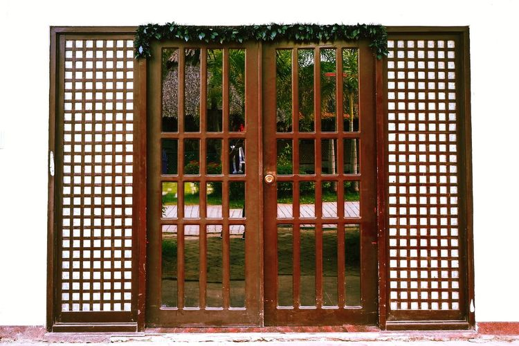 Interior Design Door Design Window Glass - Material Wallpapers Meeting Place House Vacations Frames Architecture Security Safety Grid Metal Protection Metal Grate No People Day Outdoors Architecture Wood - Material Open Close-up