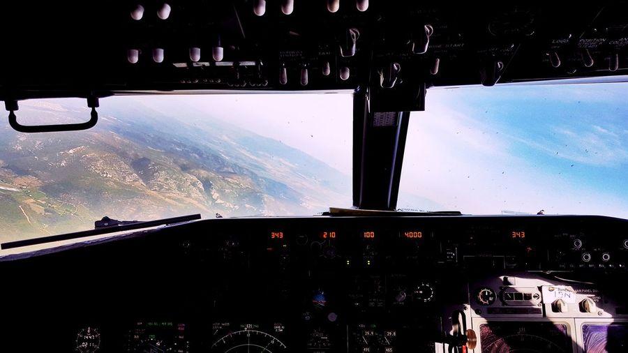 Landscape shot through airplane cockpit