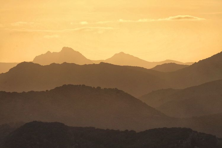Sunset recession Mountain Mountain Range Beauty In Nature Scenics - Nature Sky Sunset Tranquil Scene Landscape Outdoors Orange Color Silhouette Environment No People Remote