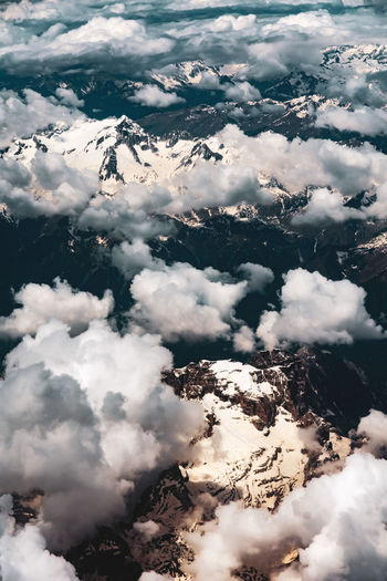 fly over views of the alps Cloud - Sky Sky Beauty In Nature Nature Scenics - Nature Day No People Tranquility Tranquil Scene Outdoors Mountains Mountain Range Alps Europe European Architecture High Angle View Looking Down Cloudy Snow Snowcapped Mountain Italian Flying Cold Temperature Blue