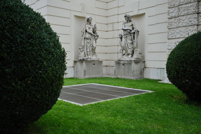 Statues in Vienna park Antique Austria City Classic Vienna Architecture Art And Craft Courtyard  Grass Green Color Growth Human Representation Male Likeness No People Park Park - Man Made Space Representation Sculpture Statue Tourism