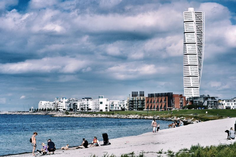 Calm beach with buildings in background
