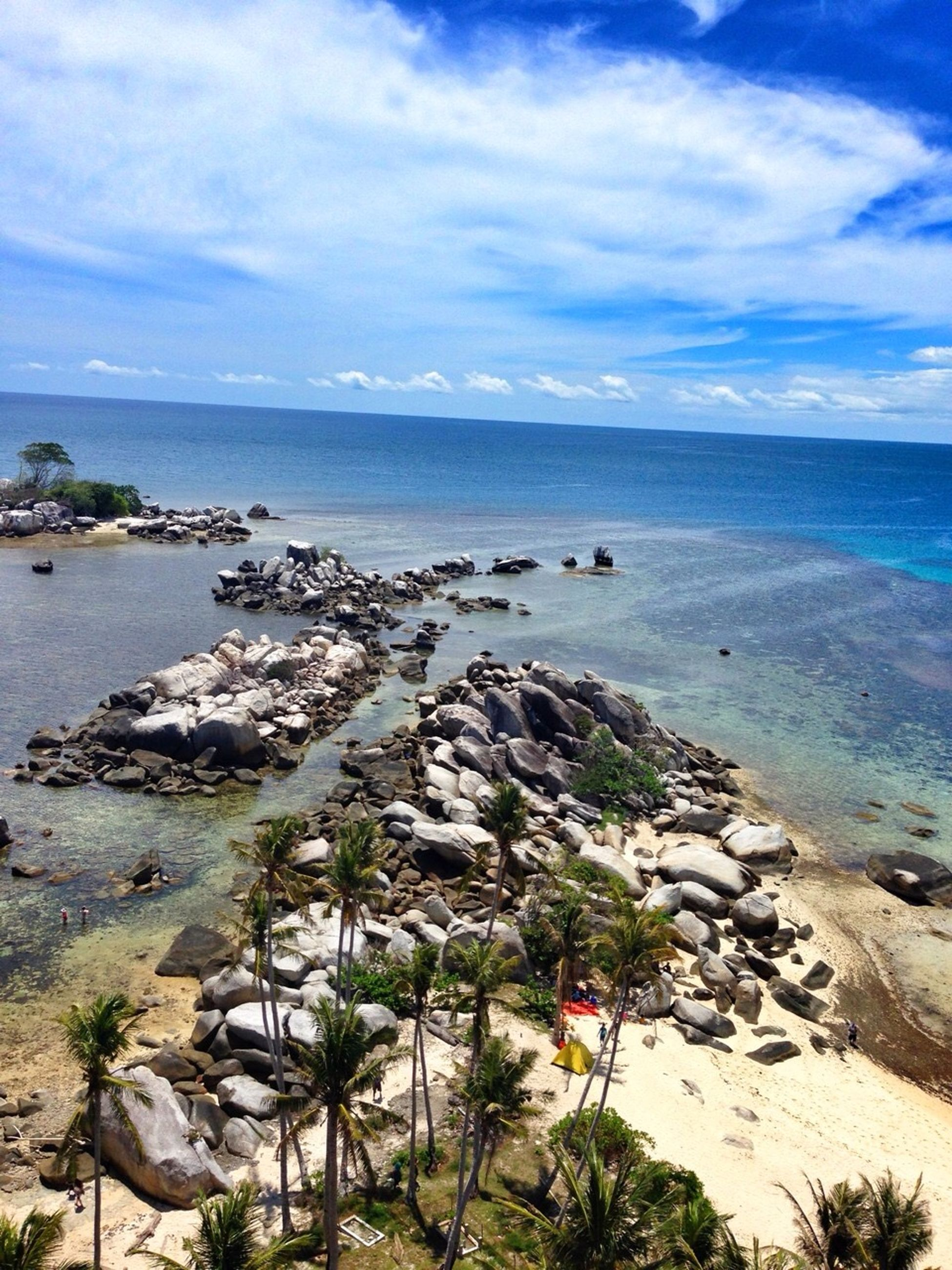 sea, water, sky, horizon over water, beach, tranquil scene, tranquility, scenics, cloud - sky, shore, rock - object, beauty in nature, nature, cloud, rock formation, coastline, cloudy, rock, idyllic, sand