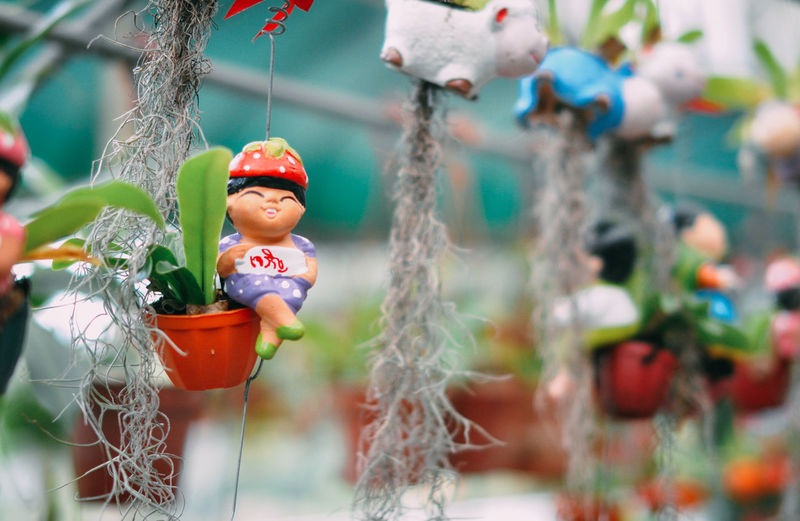 Close-up of figurine hanging outdoors