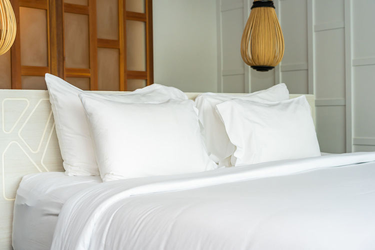 White bed in bedroom at home