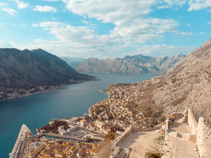 kotor.v1 Water Mountain Sky Scenics - Nature Cloud - Sky Mountain Range Beauty In Nature Nature Tranquility No People Tranquil Scene Day Travel Destinations Travel High Angle View Lake Architecture Built Structure Outdoors Mountain Peak