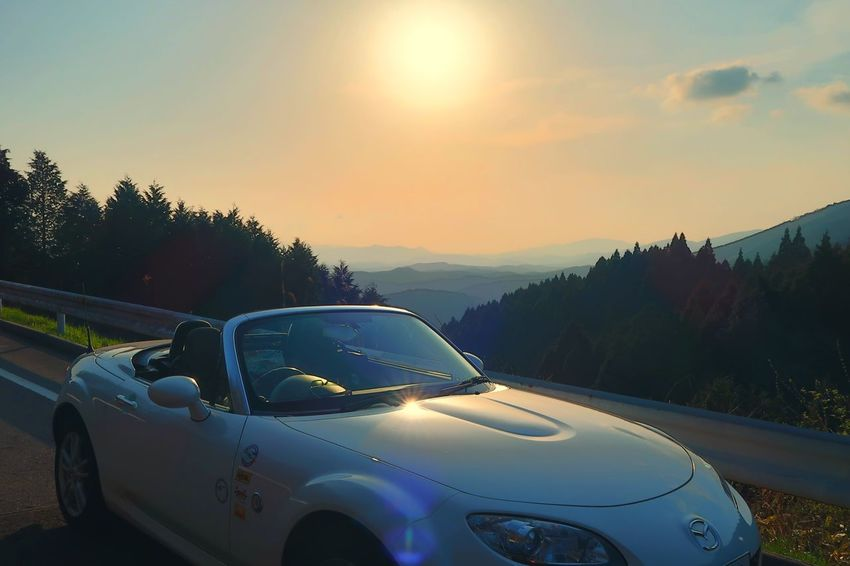 Car Sunset No People Road Landscape Sky Mountain Nature Beauty In Nature Mazda Mx5 Miata マツダ ロードスター Outdoors Day 山 春 Road Springtime Field Growth Sunlight Spring Nature