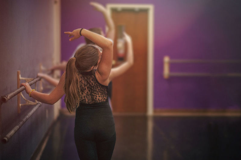 Rear view of girl practicing ballet