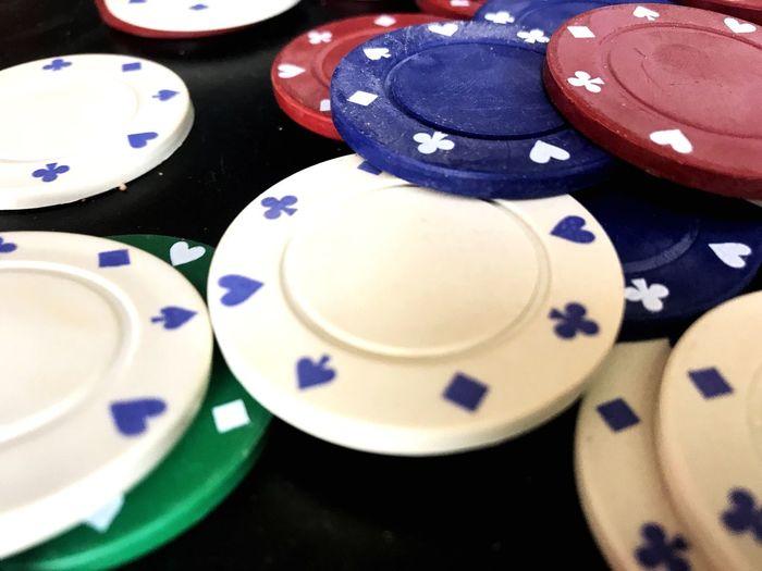 Gambling Table Luck Gambling Chip Indoors  Chance Close-up No People Poker - Card Game Gambling Poker Chips Luck Poker Night Black Background Studio Shot