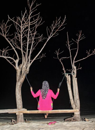 One Person People Woman Bare Tree Pink Color Black Background Beach Outdoors Night Sand Beach Swing Water First Eyeem Photo Low Angle View Thousandisland EyeEmNewHere EyeEm Gallery EyeEm Best Shots