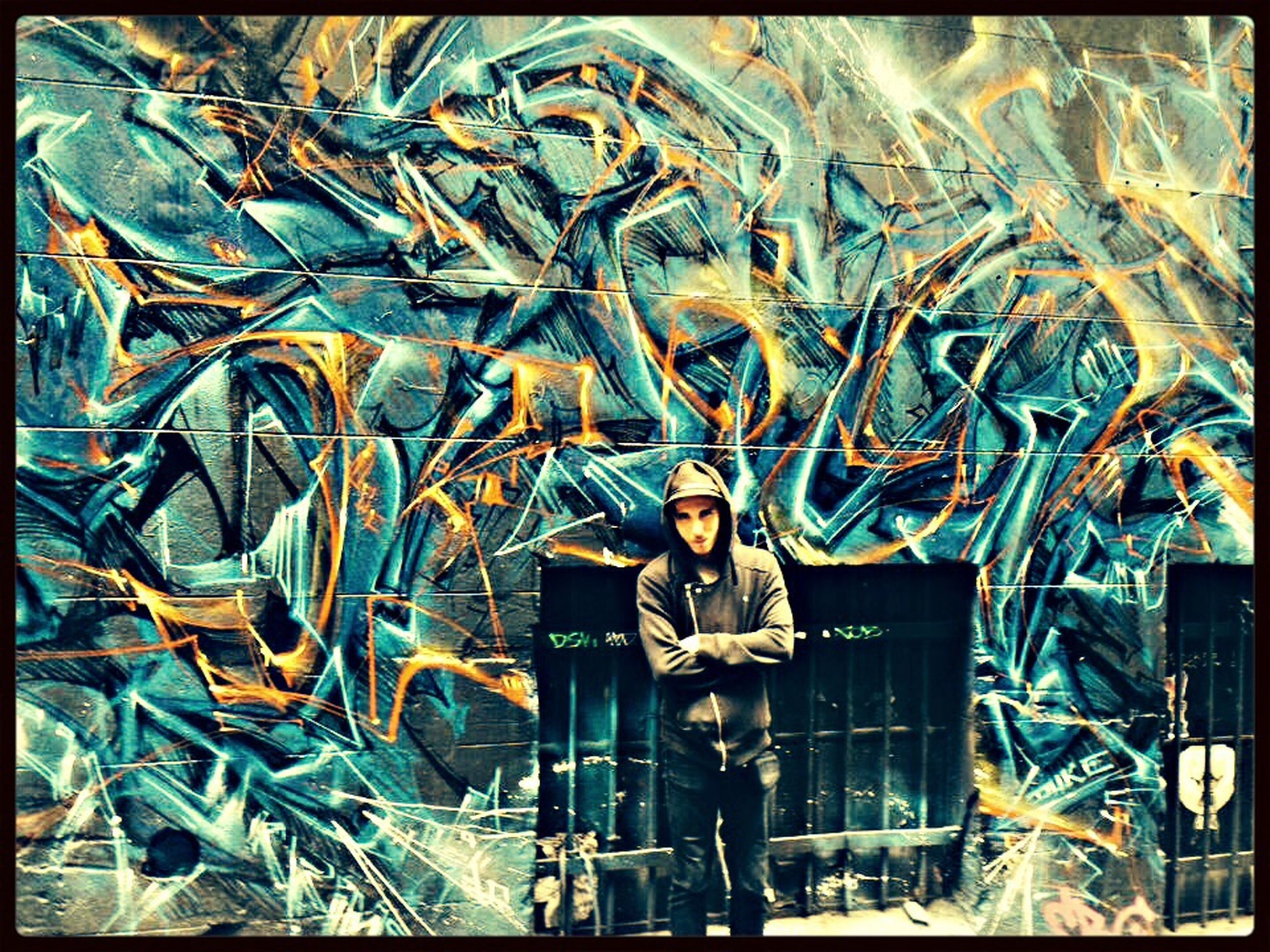 transfer print, art, art and craft, graffiti, creativity, auto post production filter, human representation, built structure, wall - building feature, architecture, building exterior, animal representation, outdoors, day, statue, sculpture, wall, old, no people