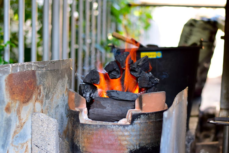 Close-up of burning firewood in container