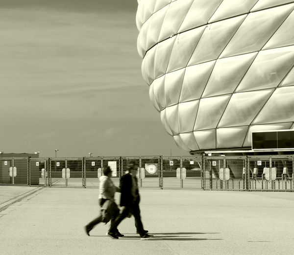 All Allianzarena Architecture ArtWork Black & White Blackandwhite Blackandwhite Photography Bnw_captures Built Structure Day Fcbayern Full Length Leisure Activity Men Munich, Germany Outdoors Real People Rear View Sitting Sky Streetphotography Travel Destinations Two People Visiting Walking