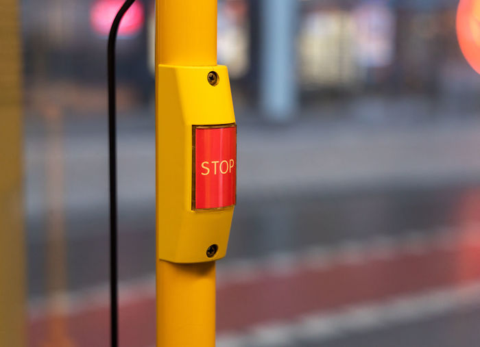 Close-up of yellow sign on pole
