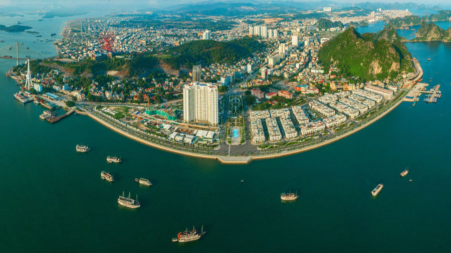 Ha Long City Ha Long Bay High Angle View Day Travel Destinations Built Structure Boats Transportation Building Exterior City Sea Cityscape Aerial View Bay Mode Of Transportation Waterfront