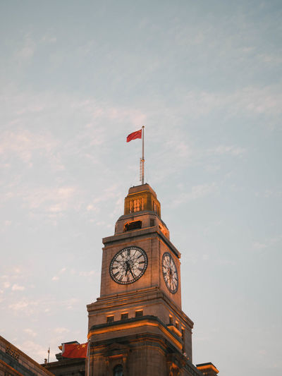 Shanghai  angle view of clock tower against sky