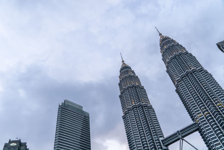 Sunset at Petronas Twin Towers KLCC, Kuala Lumpur Architecture Built Structure Building Exterior Building Low Angle View Skyscraper Office Building Exterior Sky Tall - High Tower Cloud - Sky City Travel Destinations Spire  Modern No People Office Nature Travel Financial District