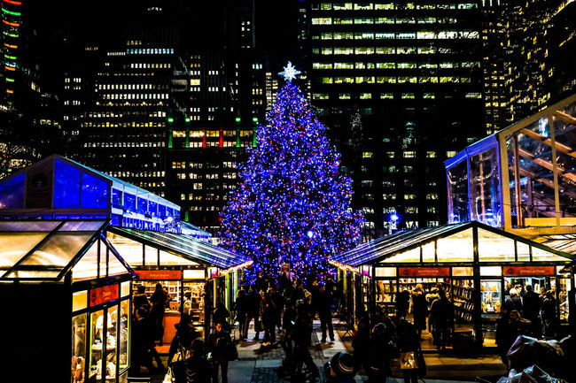 Night time in NYC with a little cheer. Architecture Bryant Park  Bryant Park NYC Built Structure Celebration Celebration Event Christmas Christmas Decoration Christmas Lights Christmas Tree Holiday - Event Illuminated Lighting Equipment Midnight New York Night Nightphotography NYC NYC Parks Outdoors People Travel Destinations Tree Winter Village Winter Village Bryant Park