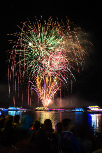 Water Illuminated Multi Colored Cityscape Firework Display Arts Culture And Entertainment Celebration Firework - Man Made Object Reflection Exploding