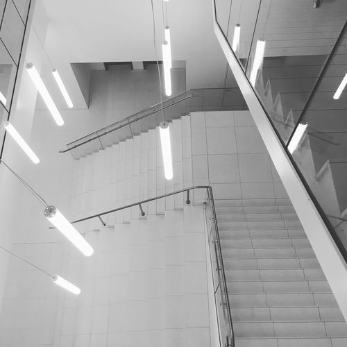 White Stairs White Walls Architecture Sign Built Structure No People Arrow Symbol Indoors  Guidance High Angle View Direction Staircase Sunlight Travel Ceiling Wall - Building Feature