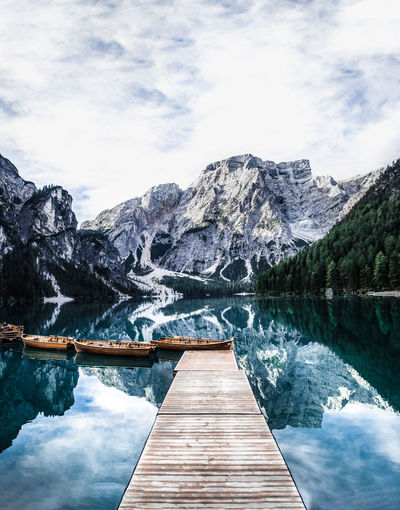 Mountain Water Cloud - Sky Beauty In Nature Sky Scenics - Nature Wood - Material Tranquil Scene Tranquility Lake Nature Mountain Range Non-urban Scene Day Idyllic Direction The Way Forward Pier No People Outdoors Footbridge Snowcapped Mountain Wood Paneling Formation
